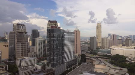délkelet Ázsia : Manila, Philippines - Sept 3, 2015: Stormy clouds gothering over Makatis skyline. Makati is one of the most developed business district in Metro Manila, Philippines.