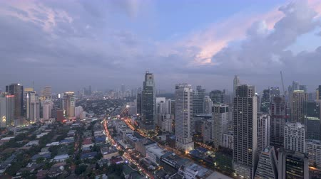filipíny : Manila, Philippines - Dec 27, 2016: Day to night timelapse of Manila ( Makati City ) skyline. Makati City is one of the most developed business district in the Philippines.