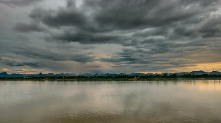 the mekong : Time Lapse of majestic Mekong river flowing and scenic sky. Stunning landscape in Laos on the opposite bank, viewed from Thailand riverside.