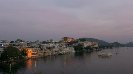pichola : Udaipur Rajasthan India. Time lapse at sunset from above. Travel destination and tourism landmarks.
