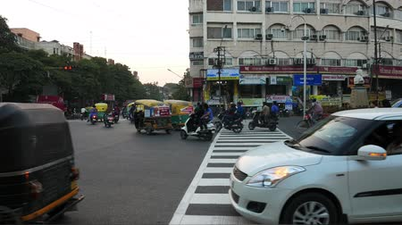 rickshaw : Indore, India - circa November, 2017: people and car traffic in the street at Indore, Madhya Pradesh, India. Stock Footage