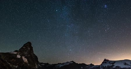 ethereal : starry sky Time Lapse over the majestic Matterhorn Matterhorn mountain peak and the Monte Rosa glaciers, italian side.