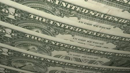 investing : Close up of text on United States one Dollar bill, notes overlaid flat. Stock Footage