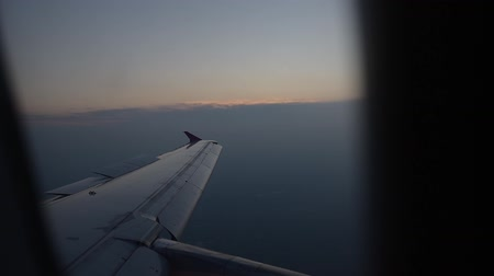 sztratoszféra : View of flying airplane wing through plane window.