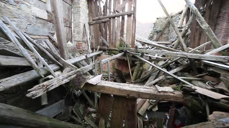 földrengés : rubble and broken wooden planks and the ruins of the House destroyed by powerful earthquake Stock mozgókép