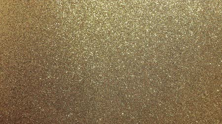 glittery golden background with many shimmering bright reflecting light