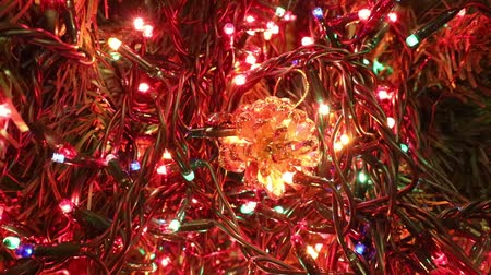 flashing light led and a golden pine cone