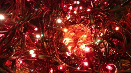 flashing light led decoration of a Christmas tree and a golden pine cone