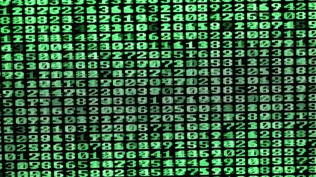 Many green numbers scroll on a computer screen Stok Video