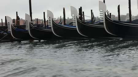 Gondolas are the turistic boats in Venice