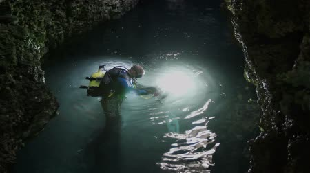 barlang : Diver filming on the water surface in the cenote, Cuba Stock mozgókép