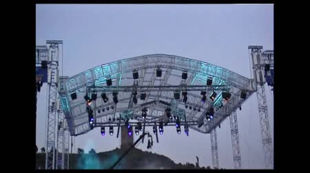 roll : Metal platform over the stage with lights during an outdoor concert