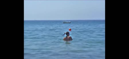 dips : A girl swimming in the sea