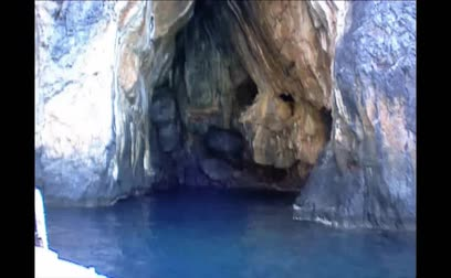 entrance : A boat going in a sea grotto, Palinuro, Italy