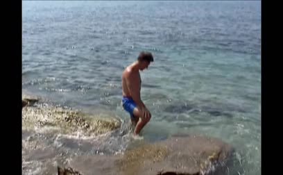 plunging : A man walking at seashore