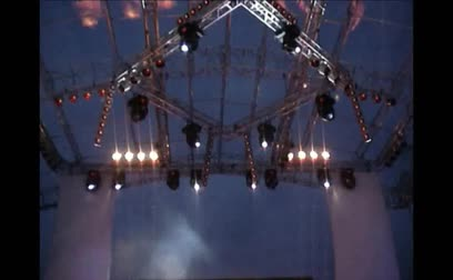 stage theater : Metal platform over the stage with lights during an outdoor concert