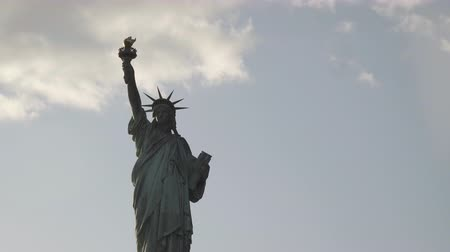 dourado : Close up shot of Statue of Liberty filmed in the sunset from the river in New York, United States of America