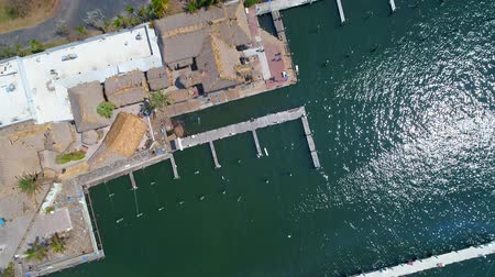 Drone flying over a marina 4k
