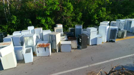 országúti : Aerial drone shot old appliances Florida Keys Hurricane Irma debris on the road
