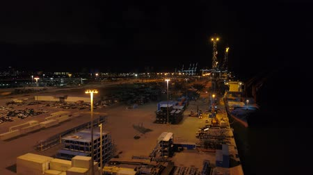 megvilágított : Port of Miami at night drone aerial 4 Stock mozgókép