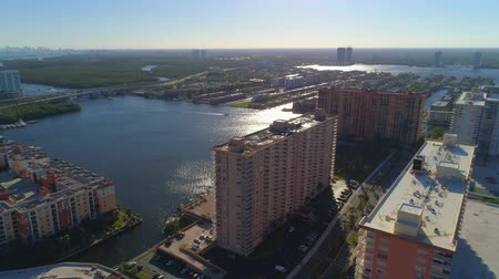 Aerial video Sunny Isles Beach FL apartment buildings on the Intracoastal Waterway