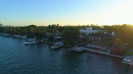 tilt down : Rich and famous homes in Miami aerial video