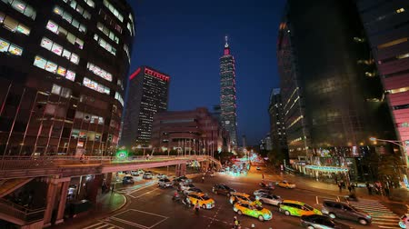 icc : Taipei World Trade Center and Taipei 101 in Xinyi Business District as traffic passes through a busy intersection at dusk  Stock video Clip Length 0:35 Stock Footage