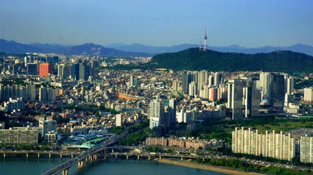 jongno : Aerial shot of Seoul City Skyline and N Seoul Tower with traffic bridge, South Korea.