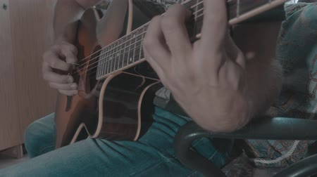 brazil : Man playing music on acoustic guitar