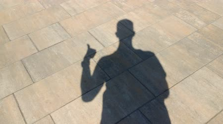 frightful : The shadow of a man shows gesture cool Stock Footage