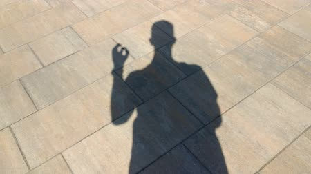 hallucination : The shadow of a man shows gesture ok Stock Footage