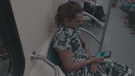 handrails : The girl in the subway with phone Stock Footage
