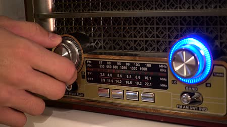 szépia : Adjusting the volume knob of the retro radio
