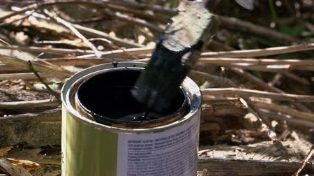 simir : Brush immersed in a jar of black paint
