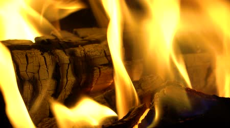 Horizontal panorama of wood, covered hot flame
