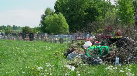headstone : A lot of garbage with wreaths and flowers