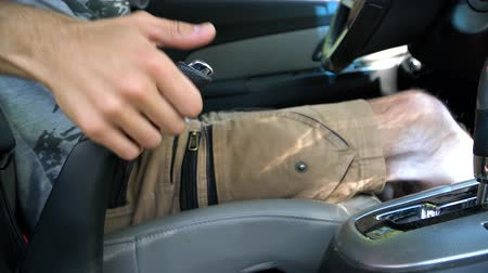 rozchod : A man sitting in the car and releases the handbrake