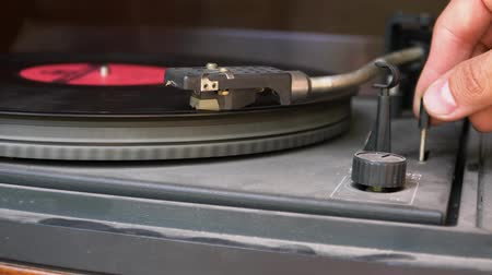 gramophone : An old dusty vinyl record player twists the plate
