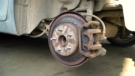 truck stop : Rusty brake disc on the caliper of the car