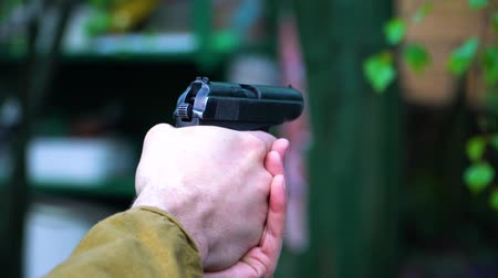 ear protection : Close-up of the hands of a man who makes a gun two shots