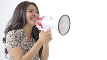 мегафон : woman shout using megaphone Стоковые видеозаписи