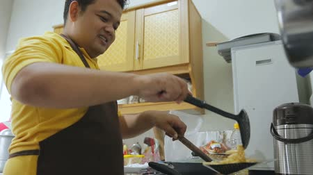 bowls : Young fat man preparing his food Stock Footage