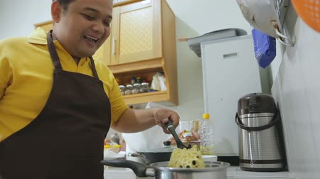 porky : Young fat man preparing his food Stock Footage