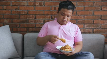 porky : fat male asian thinking about diet