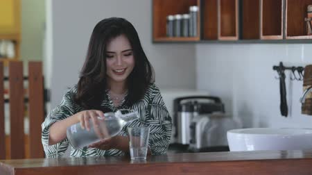 indonesian : Woman drinking water Stock Footage