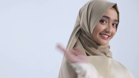 forgive : Young muslim woman