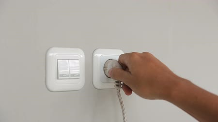 pulling off : putting plug into electricity socket