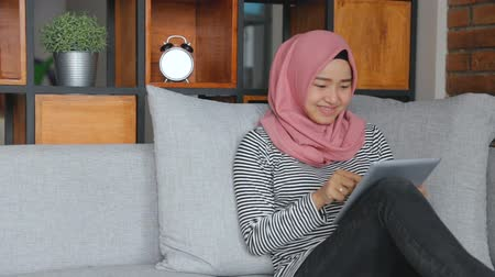 indonesian : woman relaxing in living room