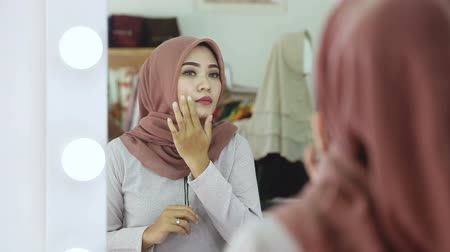 indonesian : looking for any imperfection in her skin