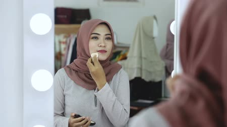 religion health : Fashion Lifestyle Portrait, woman applying make up Stock Footage